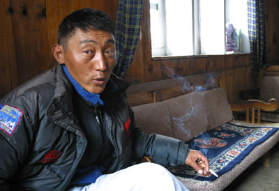 Image #030428_018  Relaxing in his office, Tsering Gyaltsen recounts the lightening storm which knocked out the internet cafe at Everest Base Camp.