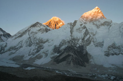 Everest and Lhotse are lit up as the sun sets over Everest base camp